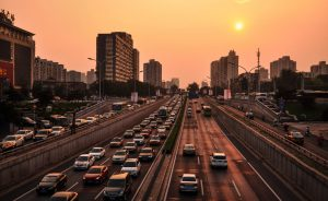 Busy traffic with a sunset in the background