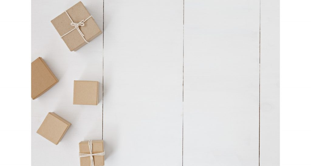 Boxes on a wooden floor. Packing is something you save on when it comes to items you don't need to pack.