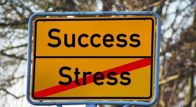 street sign success and crossed stress