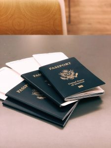 three USA passports on a table