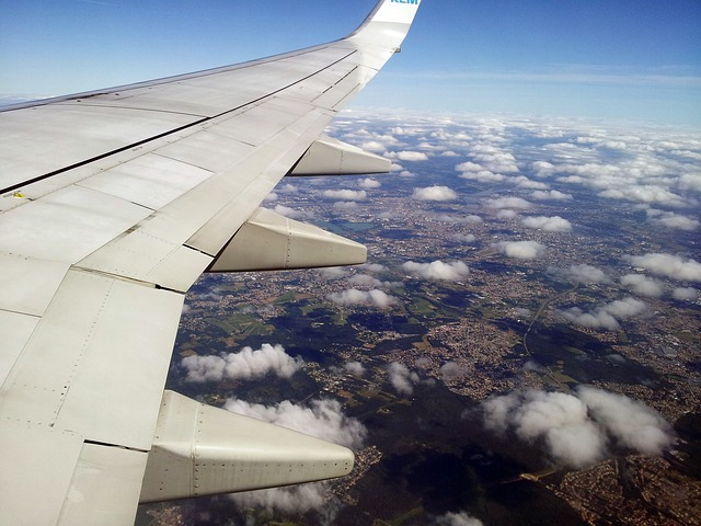 moving to a foreign country by plane, above the clouds