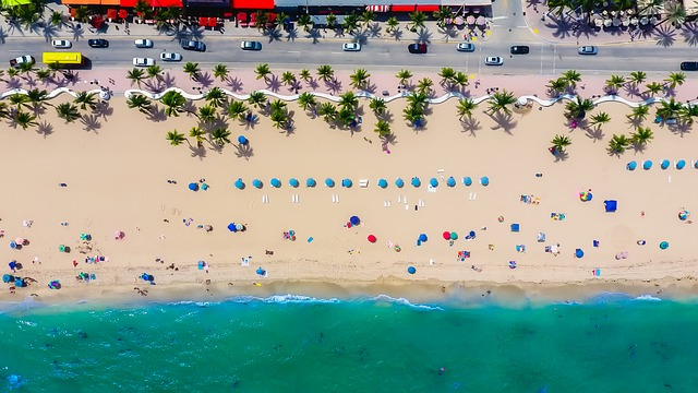 A bird's eye view of a beach, representing the process of purchasing a vacation home in Florida.