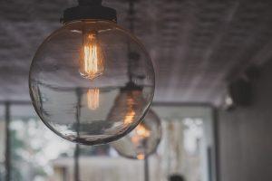 A subdued light-bulb fixture.