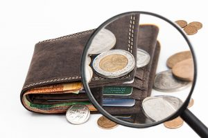 a wallet squeezed and some coins around it becuse you need home improvement ideas under $500