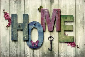 Letters spelling the word ''home'' on a wooden wall