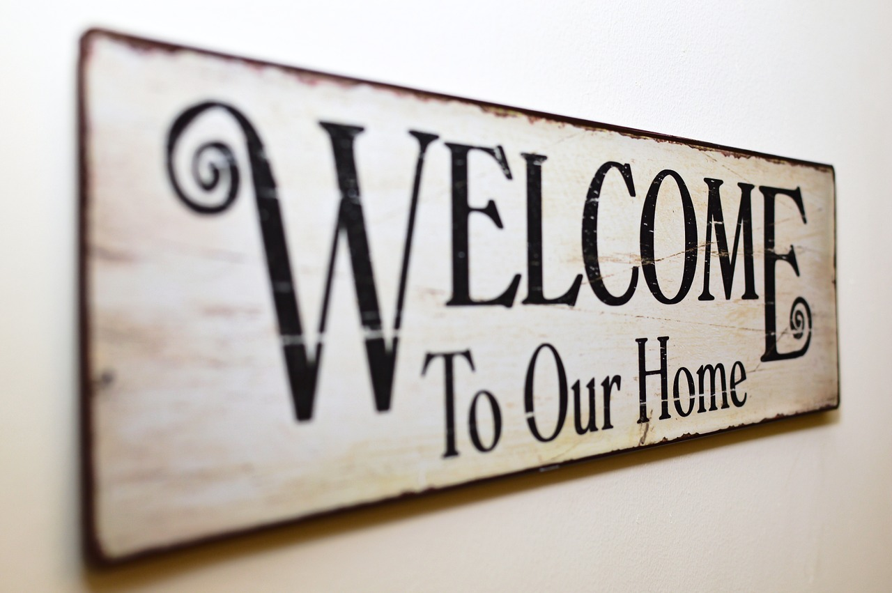 A ''Welcome to our home' door sign