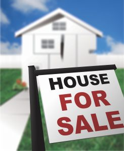 House for sale sign.