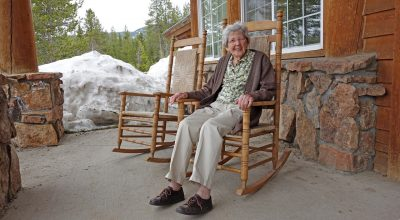 An old woman sitting in a rocking chair