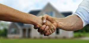 Man shaking hand as a sign of agreement
