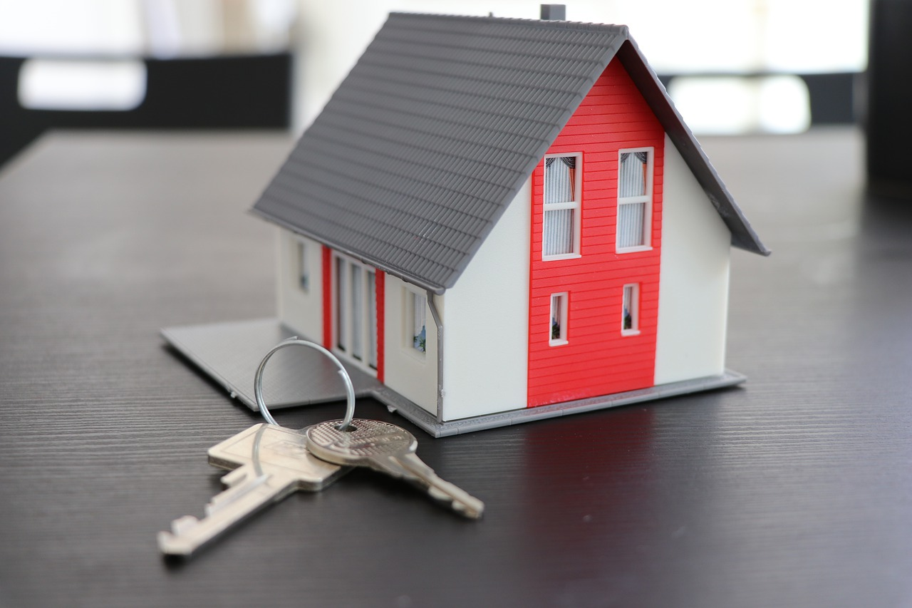 A keyring in the shape of a house.