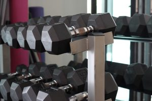 Gear rack with dumbbells on it - perfect equipment for a gym in your Dubai home