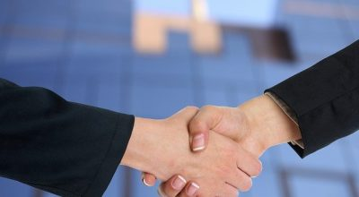 Shaking hand when buying your first luxury loft in California.