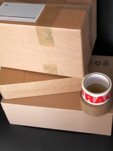 Cardboard boxes and packing tape you will need when preparing for moving to Mississippi.