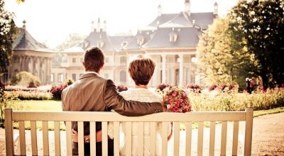"""A couple in front of their house asking themselves """"Can moving out save a relationship""""."""