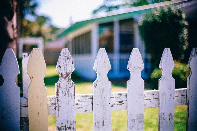 White picket fence, separating you from making friends with new neighbors