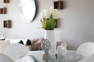 A vase and figurines on the table.