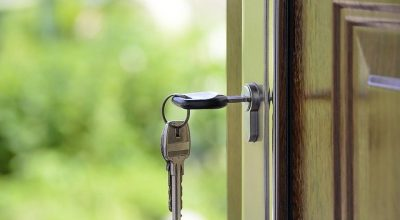 The keys in a door lock, one step closer to renting your first apartment in Boca Raton.