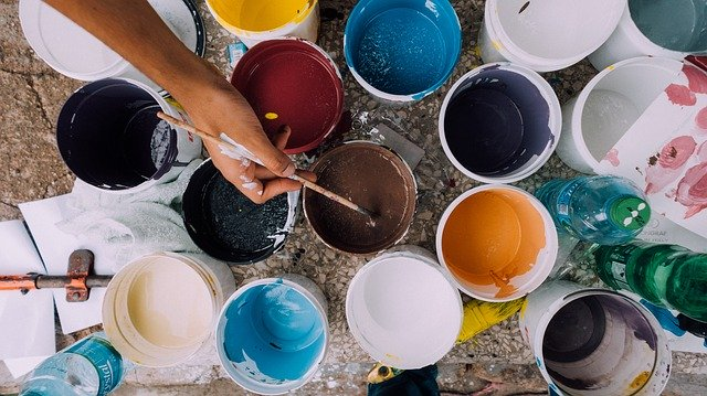 A lot of cans with paint you will need to refresh your home according to the home remodelling guide for beginners