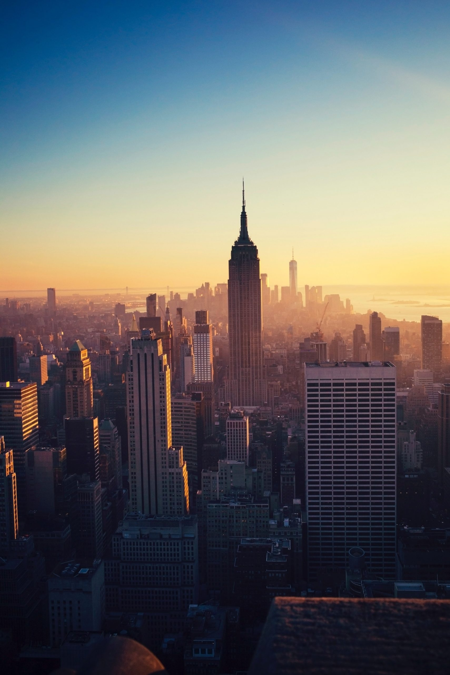 A city skyline during sunset in NYC.