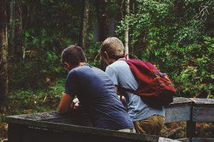 Two school boys talking.