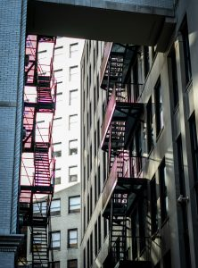 A fire escape in a building in NYC. Not having a balcony is one of the strange things about NYC apartments.