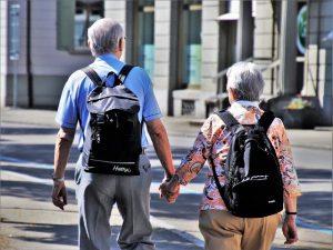 Seniors holding hand.