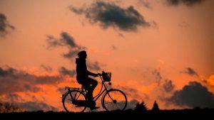A biker, silhouette.