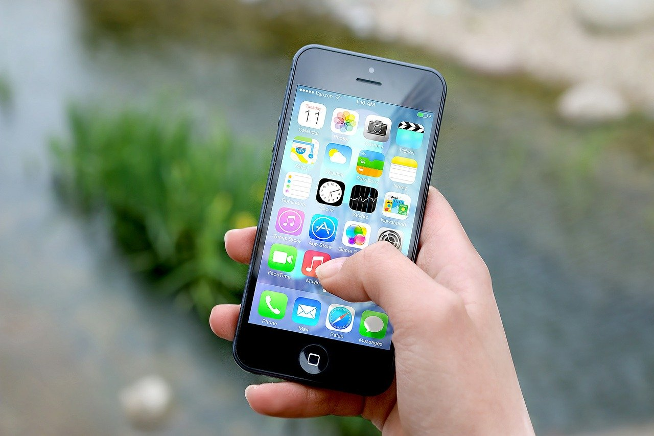 An iphone with some of the best apps for finding an apartment to rent.