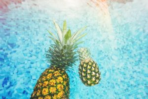 Buying a house with a pool in Florida whit pineapples in it.
