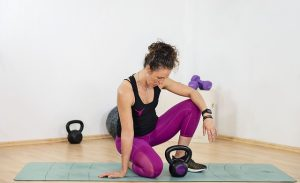 A woman exercising in her home gym.