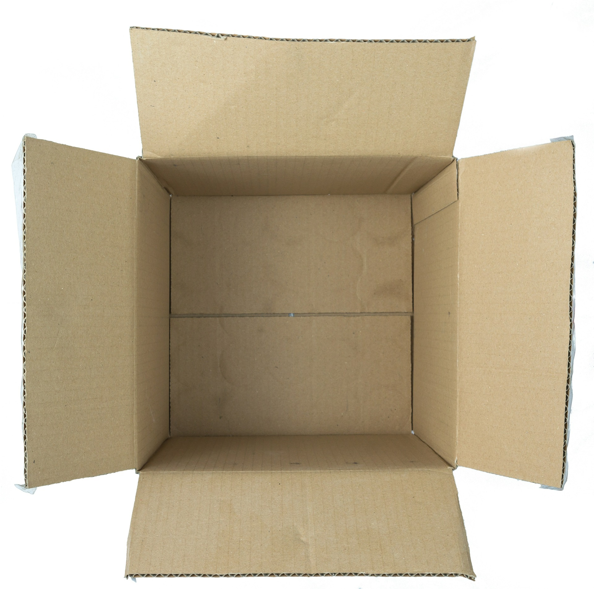 An open cardboard box while unpacking after a PCS move.