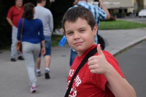A little boy showing thumbs up.