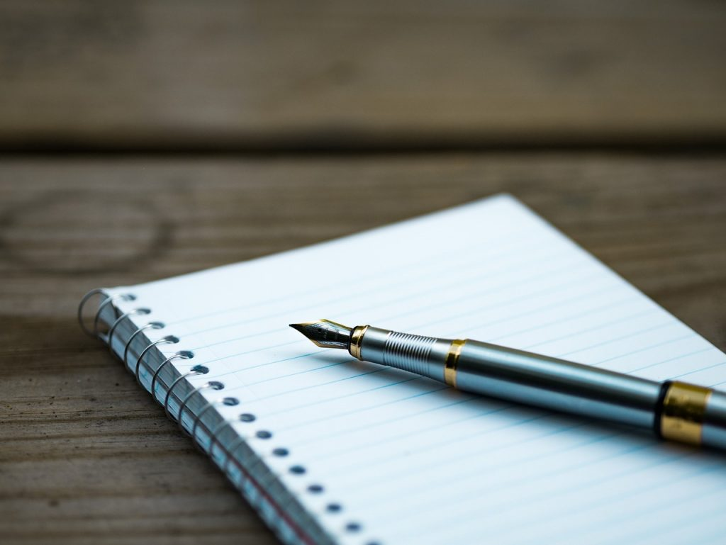 A pen on the notebook. By using it, you can write down a plan that will affect your moving and buying a home in Rockville process.