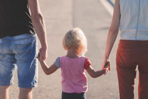 parents taking their child for a walk in one of the most beautiful communities in Morris County