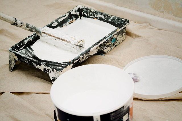 A paint can and a brush necessary for home modifications for the elderly