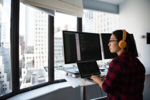 A woman working at the office with a view