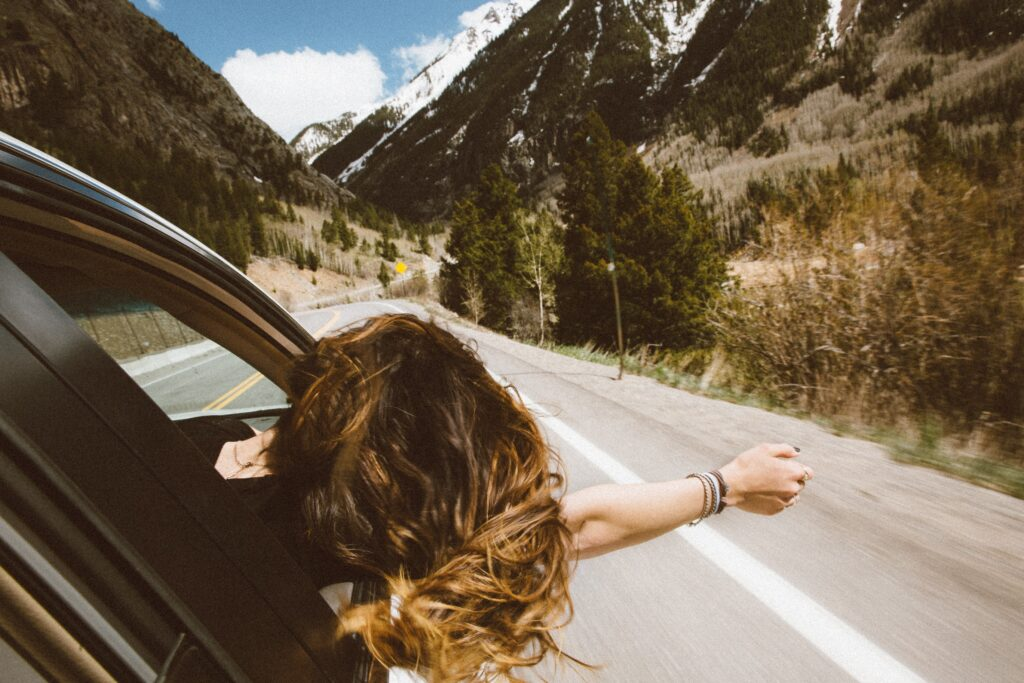Girl riding in a car to go to Idaho cities for low to middle-income households