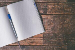 An open notebook and a pen.