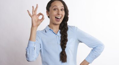 A woman showing the ok symbol for the staging tips that will wow Austin buyers.