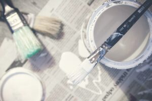 Paint cans and brushes.
