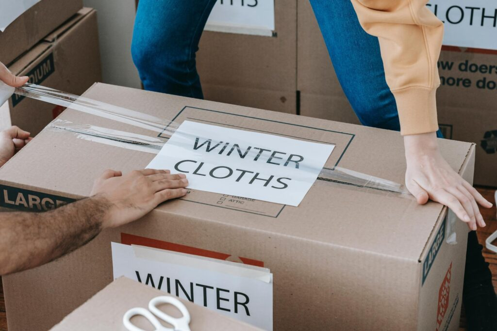 Box with packed winter clothing