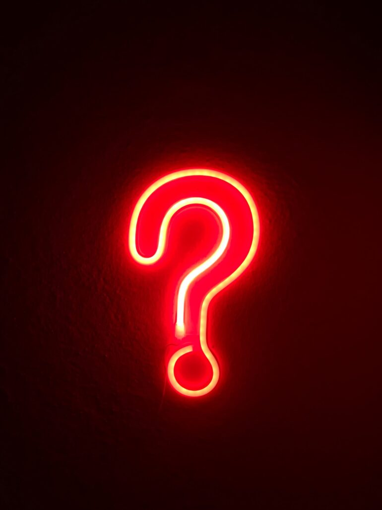 Red neon question mark.