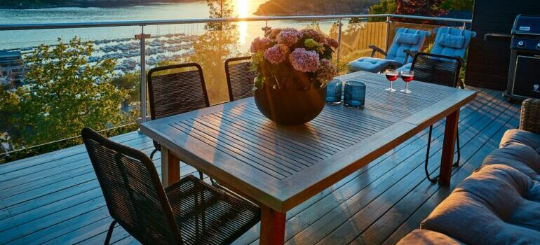 cozy furniture with flowers is one of the best tips for decorating your balcony