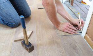 A man renovating his floor.
