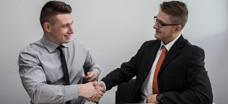 Men shaking hands after they make a deal for moving to Miami for a new job