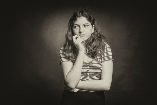 A black and white photo of a girl thinking of renting an apartment in Ontario