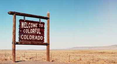 a sing that says welcome to colorful Colorado, read about house hunting in Colorado