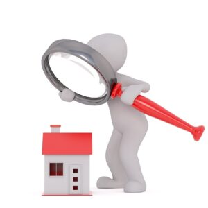 A person loking at a house and exploring Kuwait real estate market trends
